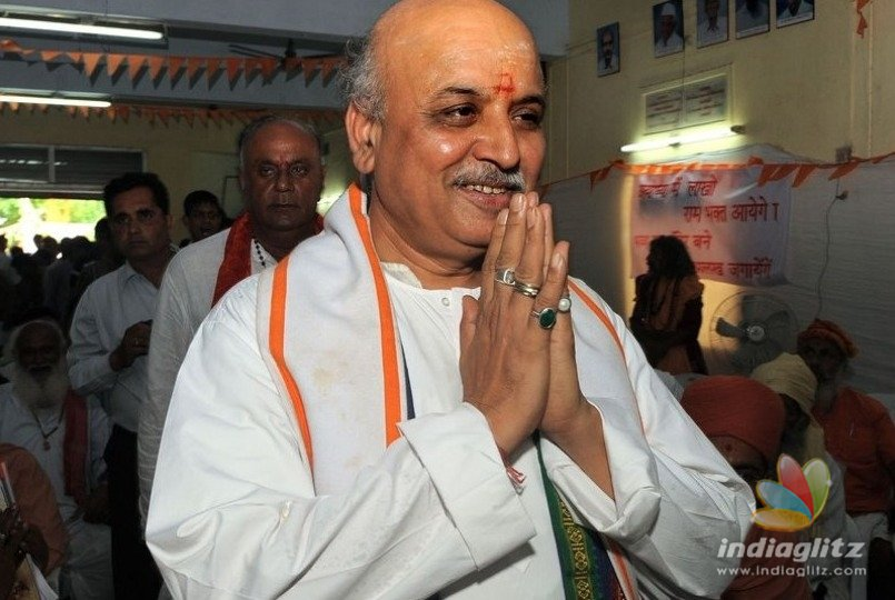 Togadia escapes unhurt as truck hits his auto