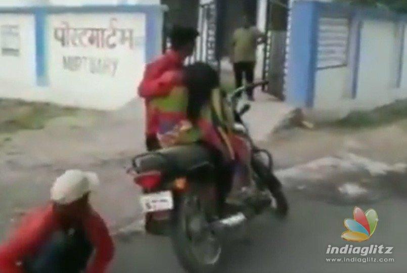 Son carries dead mother on bike for post mortem